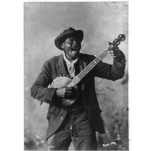 c1897,Happy John,Negro man standing and playing a banjo