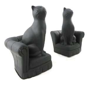 Pair of bookends Chats black sofas.