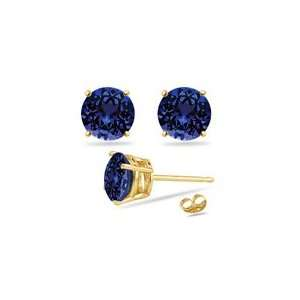 0.72 Cts Tanzanite Stud Earrings in 18K Yellow Gold