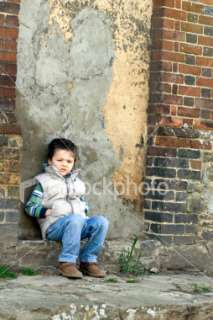 Child alone in deep thinking Royalty Free Stock Photo