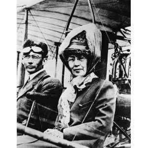 Martin with her son, Glenn L. Martin, in an early Martin plane. Martin